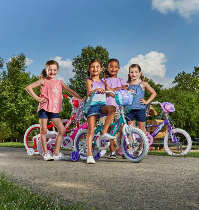 A group of young girls riding on bikes