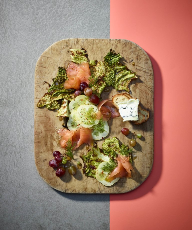 A cutting board bread on grey and pink with salmon