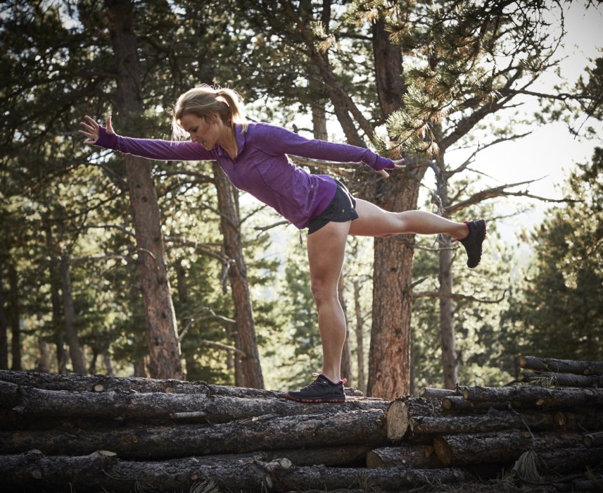 Athlete stretching in the wood