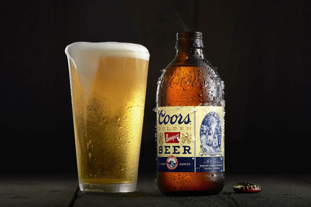 Coors Beer with foaming glass