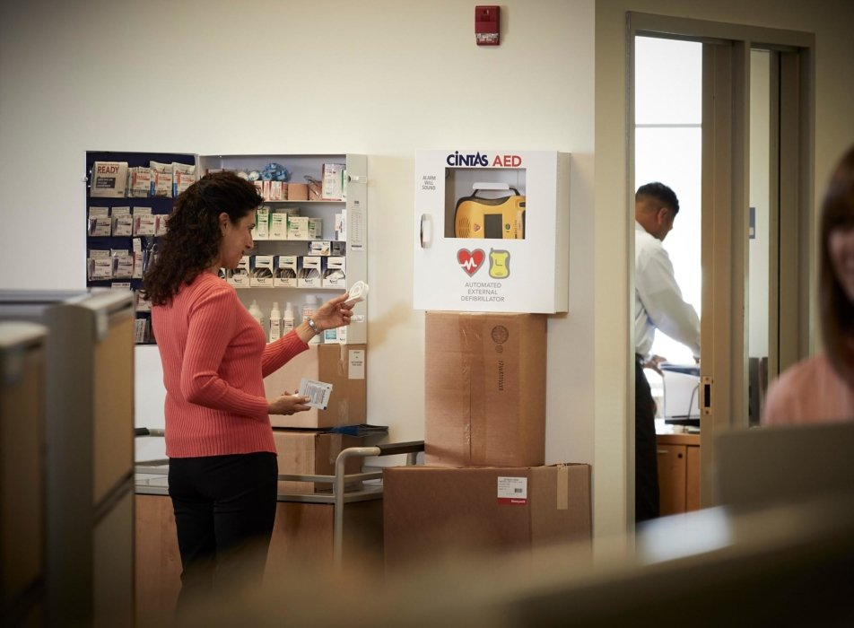 A woman inspecting some medical supplies - workplace photography