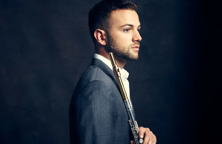 Portrait of a man with a flute - concert nova