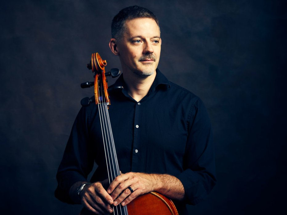 Portrait of a man with a cello close up - concert nova