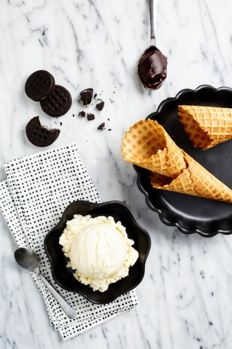 Ice cream and cones on a table