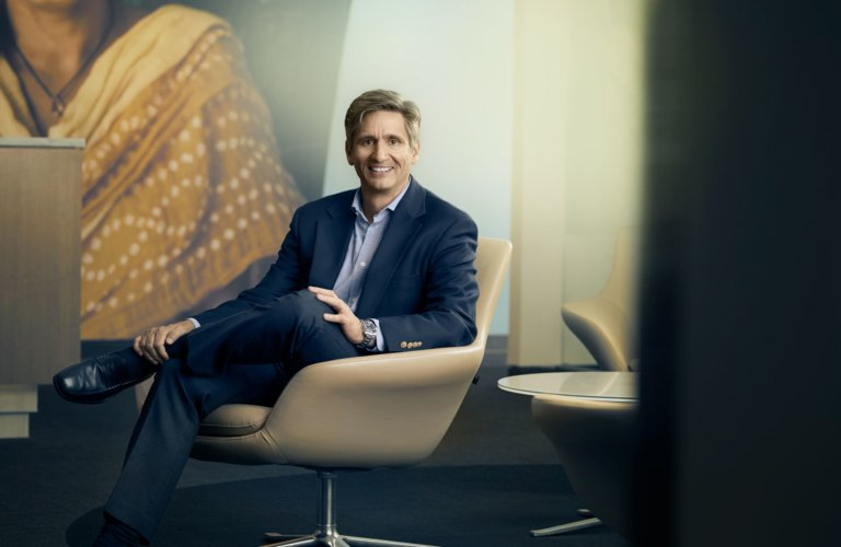 Portrait of an executive in a leather office chair