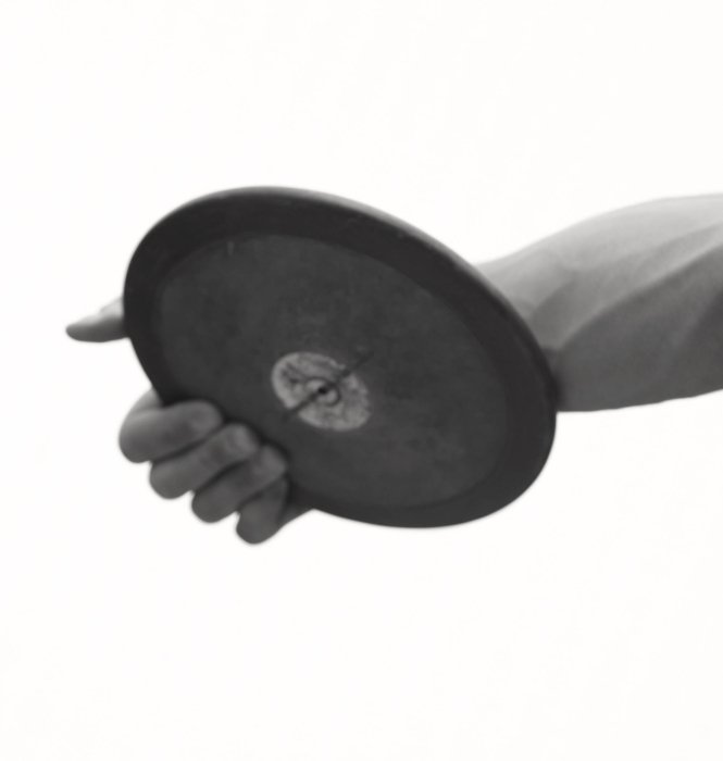 A shot of a discus disc about to be thrown