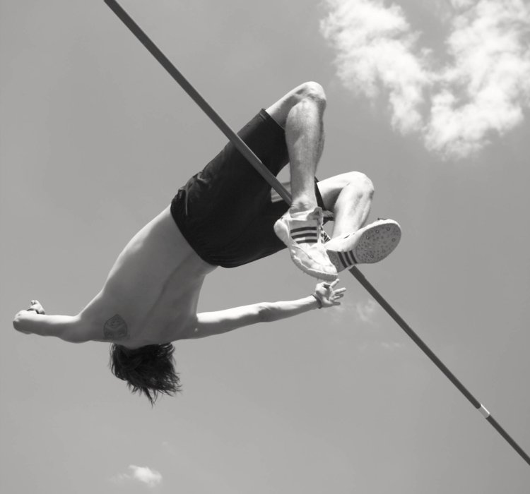 High jump athlete in the middle of a jump