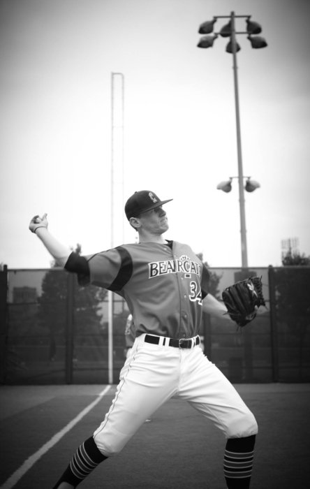A pitcher practicing the wind up