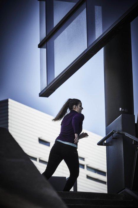 A runner woman going around a corner