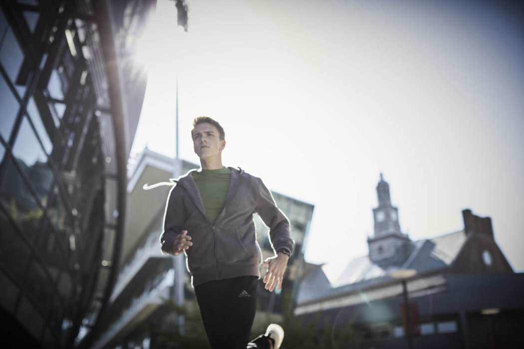 A male athlete training on a college campus