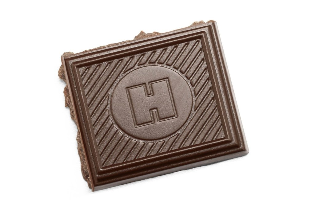 Chocolate photography - broken chocolate bar on a white background for packaging