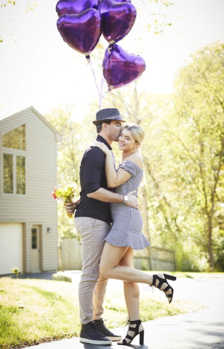 Lifestyle of couple kissing with purple heart balloons - lifestyle photography