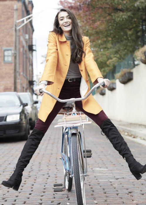 Lifestyle of girl riding vintage bike on brick road - lifestyle photography