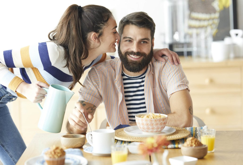 Lifestyle of a young couple enjoying breakfast - lifestyle photography