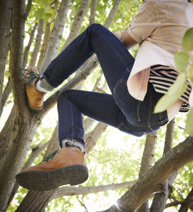 Lifestyle of a young man climbing a tree