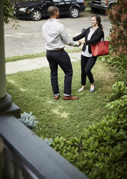 Lifestyle of a young couple having fun in their front lawn