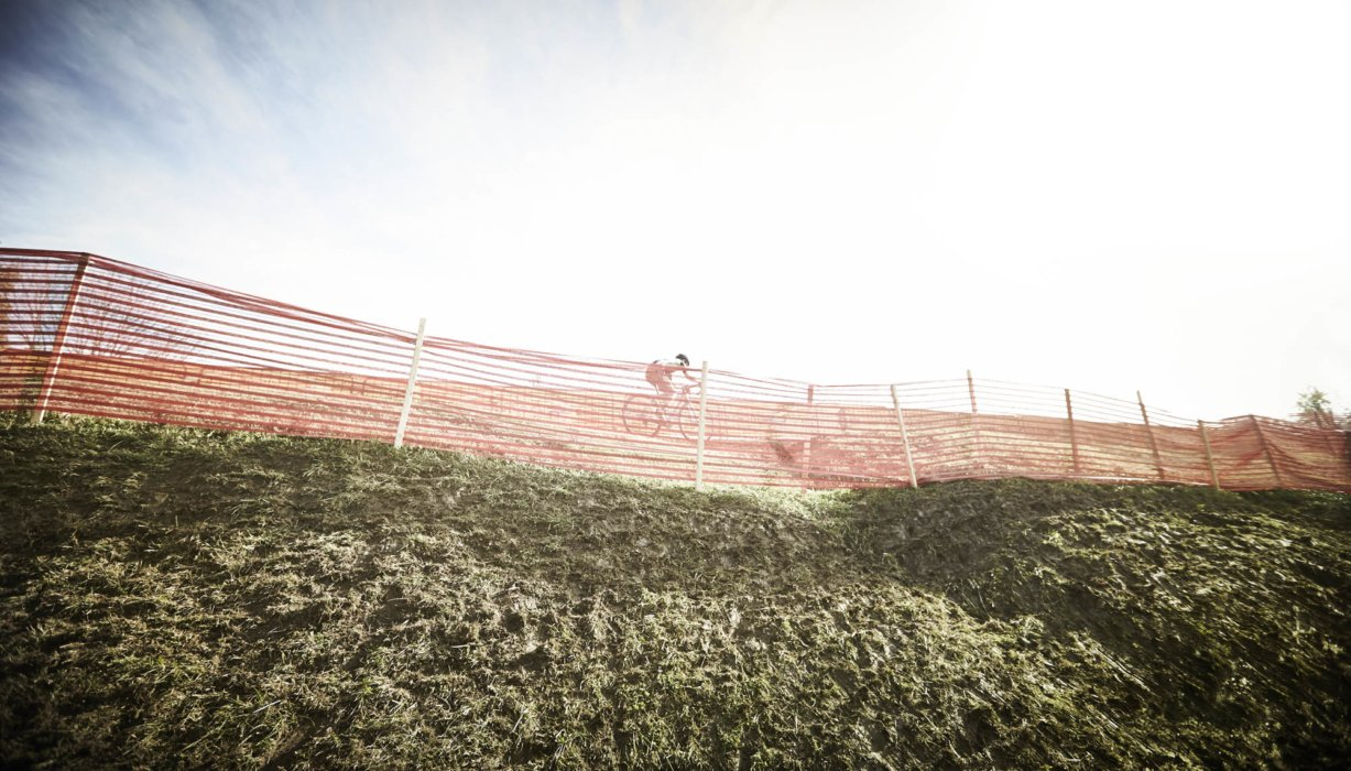 Cyclocross rider on a hill side