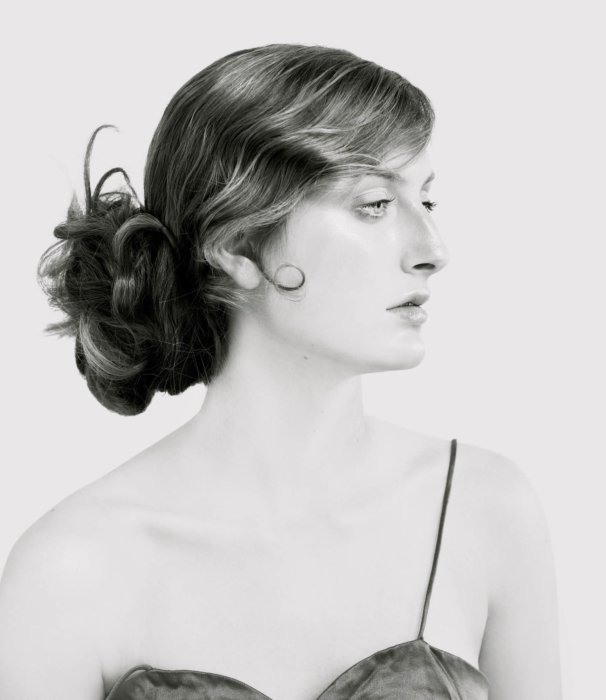 Beauty shot of a young woman in vintage cloths and hair style