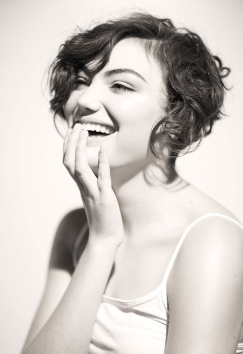 happy young woman smiling beauty shot with hand on mouth