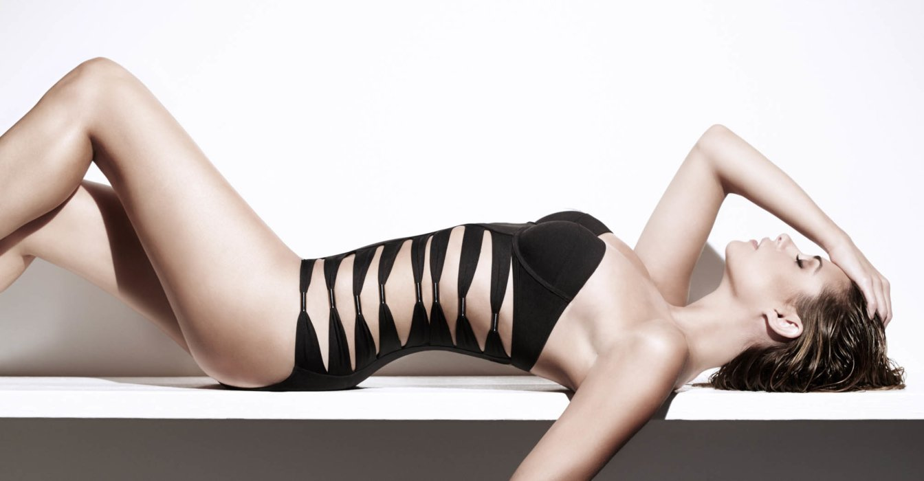 Beauty shot of a woman waring a black bathing suit
