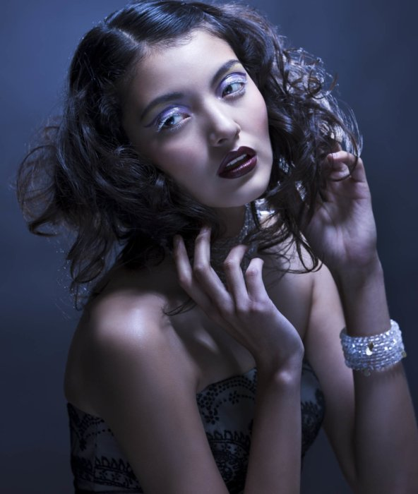 Beauty and fashion shot of a woman with dark curly hair
