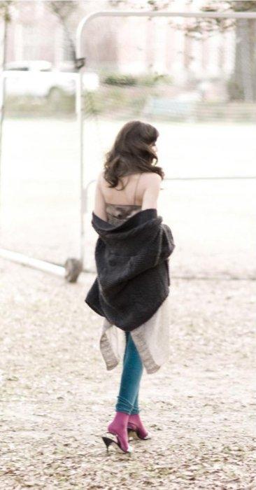 A fashion model walking in a park