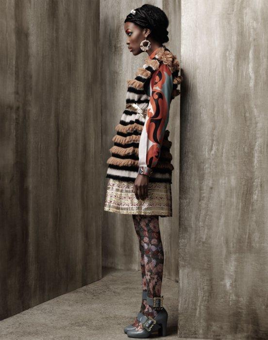 Fashion model wearing a modern dress in a tan setting