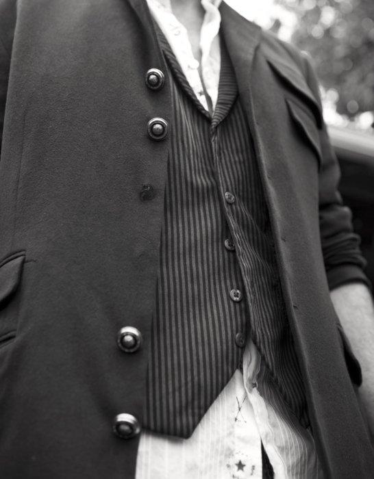 Close up fashion photo of dress shirt and vest