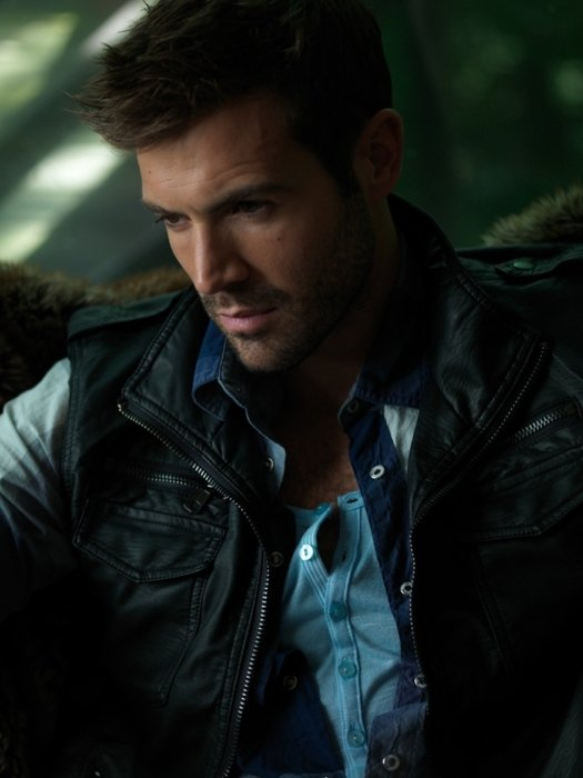 A dark image of model wearing shirt and vest
