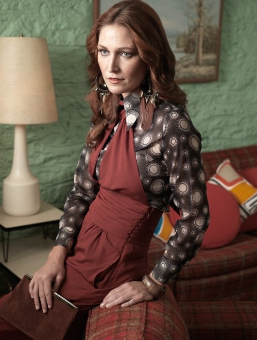 A vintage style fashion model wearing 70s clothes