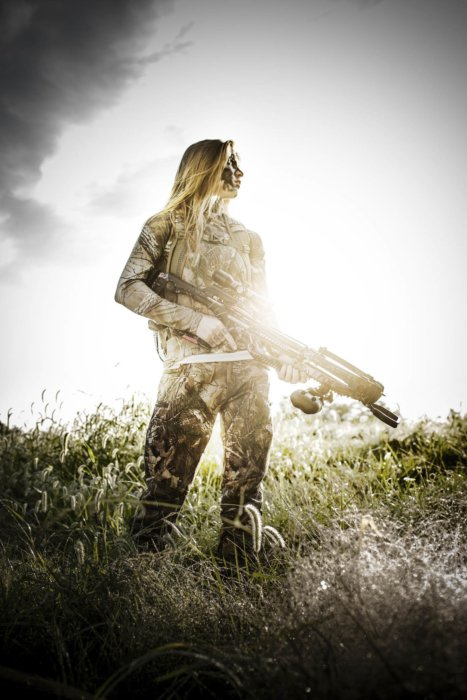 An epic female bow hunter with a cross bow
