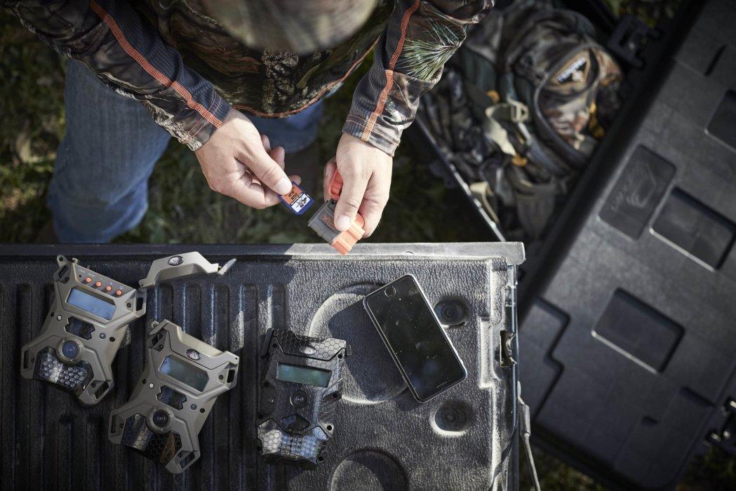 A hunter preparing motion detectors