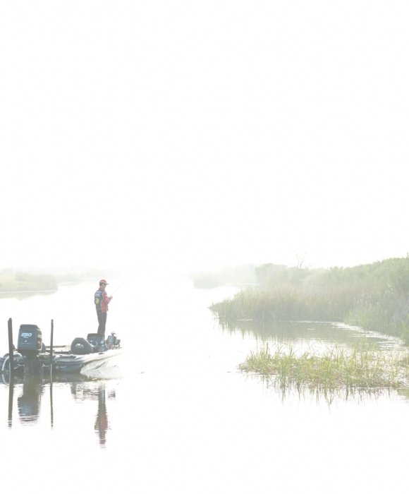 KVD freshwater fishing on a sunny morning lake