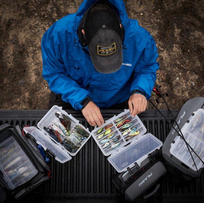 A fisherman organizing his baits