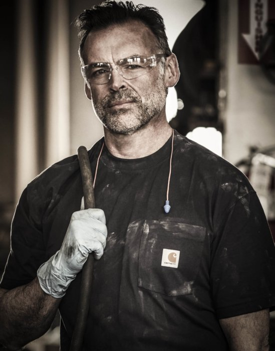 A portrait of a hard working man with carhartt work apparel