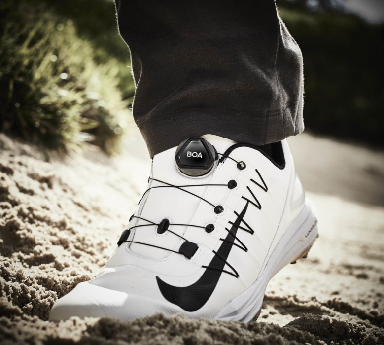 A featured shot of a the BOA shoe system on a golfer in sand
