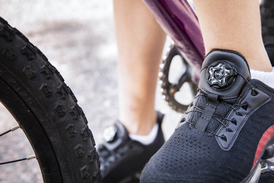 A kids habu shoe system on athlete with bike