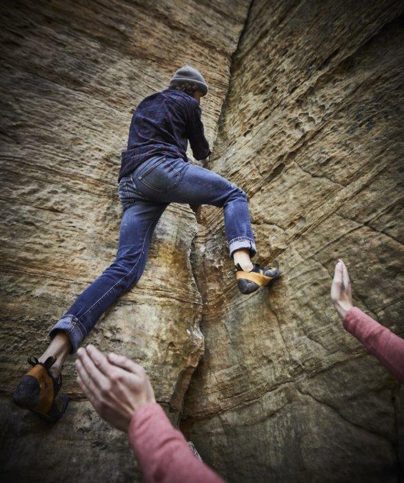 A man free climbing up a rock face