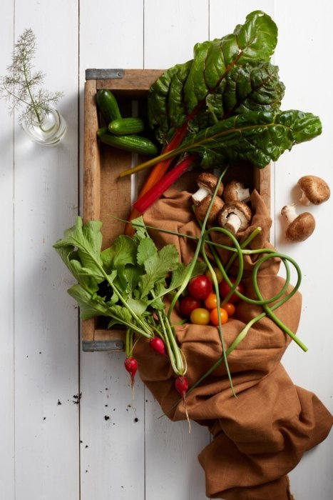 Raw vegetables coming out of a box