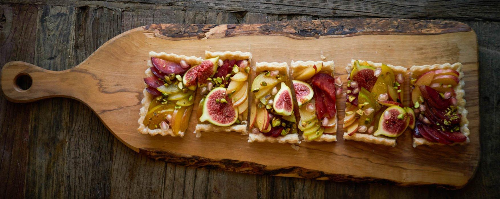 A tart on a rustic cutting board - fine art