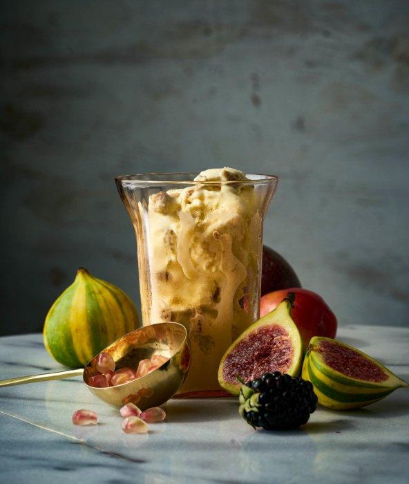 A pomegranate berry ice cream sundae