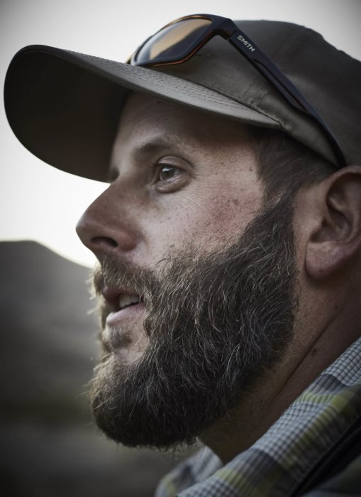 Portrait of a fly fisherman with beard outdoors
