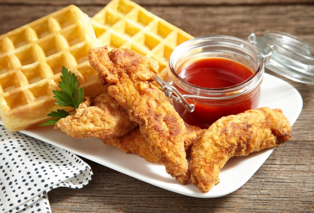 Chicken and waffles with a side of sauce