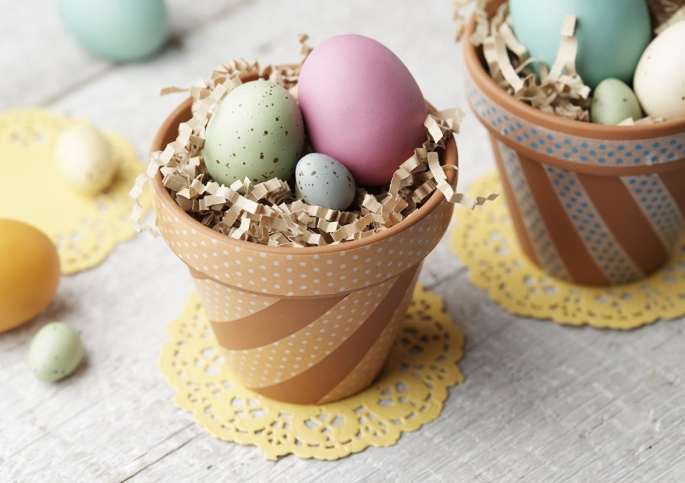 Crafted easter egg basket in terracotta pots