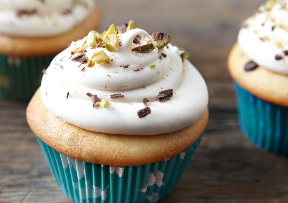 Close up vanilla cupcake white icing and toping