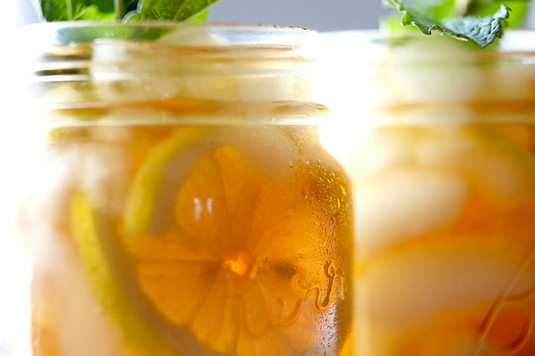 Orange drink in mason jars