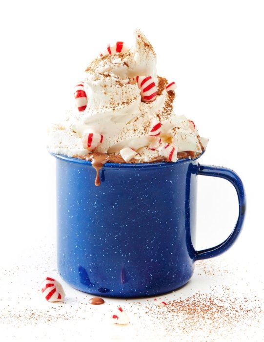 Mint chocolate drink in a speckled blue ceramic mug