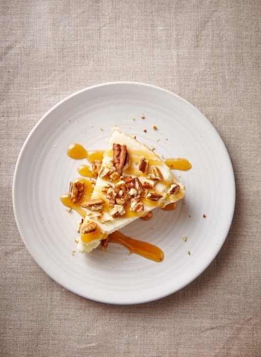 Cheesecake on with nuts on a plate