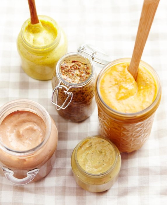 Jars of sauces with spoons