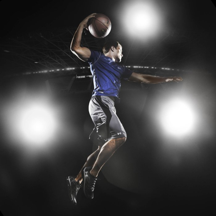 Basketball athlete action shot with bright lights